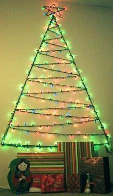 i made this christmas tree out of one strand of lights attached to the wall with clear command