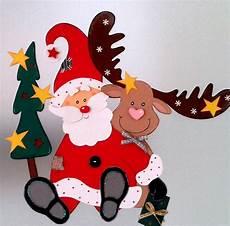 fensterbild weihnachtsmann mit elch weihnachten