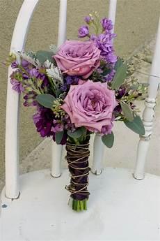 wedding flowere earthy purple wedding flowers floral design by