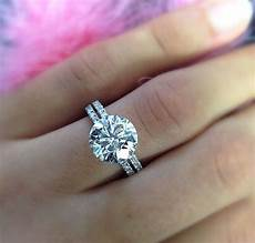 3 carat 4 prong solitaire with a dainty micropave band engagement rings diamond