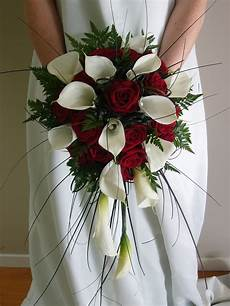 a wedding addict and white bridal bouquet