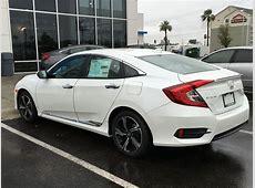 Civic Touring white with chrome side trim.   2016  Honda