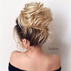 beautiful high bun hairstyle for romantic brides