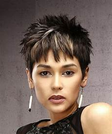 short spiky pixie haircut with long bangs short straight casual pixie hairstyle with razor cut bangs dark brunette hair color with