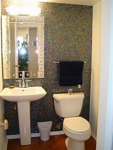 small powder bathroom ideas small powder room with large mirror and sconces on the