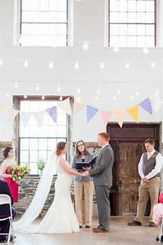 cute wedding ceremony with strands of lights and pastel