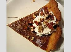 classic pumpkin pie with maple whipped cream and walnuts_image