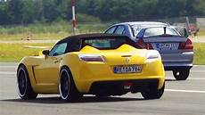 opel gt roadster cabrio vs mitsubishi lancer evolution 1 4