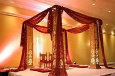 simple and elegant jali mandap with bandhani fabric wedding mandap indian wedding decorations