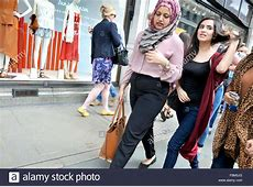 London, England, UK. Young Muslim woman and a friend
