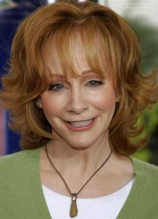 reba mcentire s practical and bouncy hair with flipped out ends