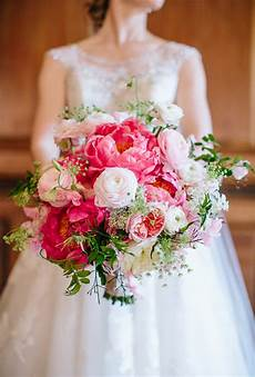 pink and white bouquet of peonies ranunculus and garden