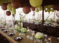 centerpieces of alternating heights decorate tables tall centerpieces of calla lilies short