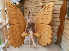 carved wooden butterfly chair with images wood