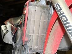 colle en bombe pour stickers protection radiateur moto cross