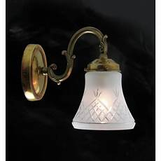 victorian brass wall light with etched glass pineapple shade