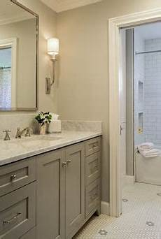 gray tile floor with white vanity bathroom ideas love how they have the tiles that looks