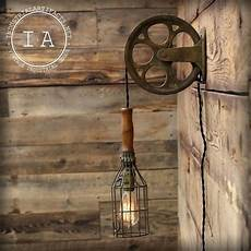 vintage industrial cast iron pulley wire cage trouble l wall light in home furniture