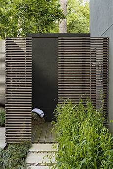 tips for incorporating outdoor showers into a landscape