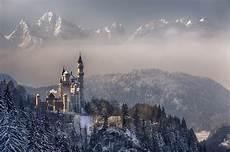 winter germany iphone wallpaper germany bayern munich neuschwanstein castle sky clouds