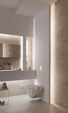 this bathroom has all the appeal of a spa with beautiful lighting warm tones and floating