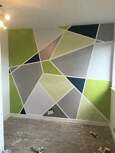 a stunning apartment with colorful geometric wall design with geometric shapes and colorful colors