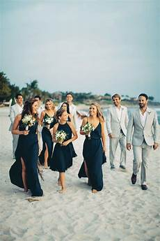 bridesmaids in blue groomsmen in grey in 2019 wedding wedding bridesmaids beach bridesmaid