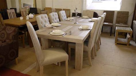 solid oak extending dining table and 8 matching linen