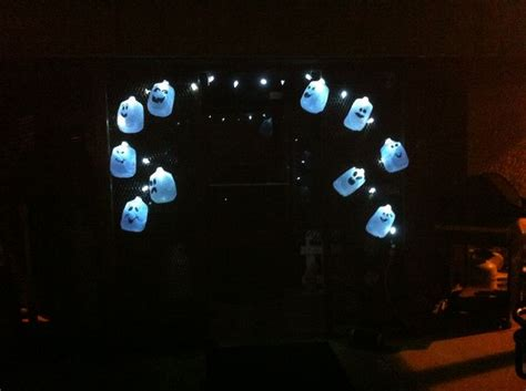ghosts made from milk jugs and christmas lights