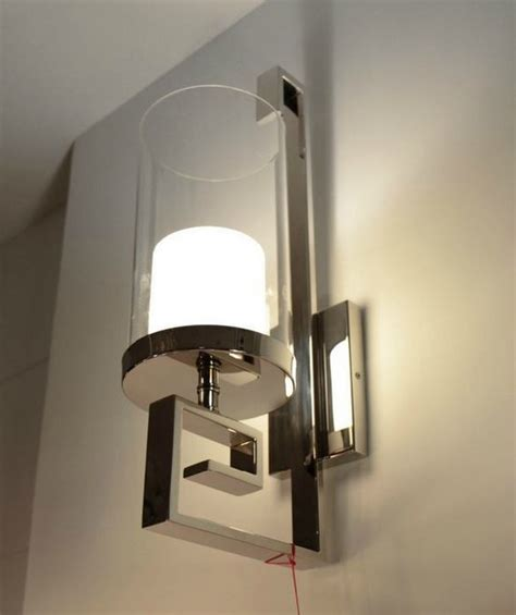 modern steel and glass wall sconce in polished chrome