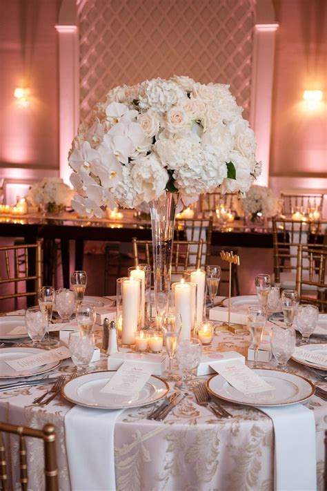 tall white centerpieces blush uplighting candles
