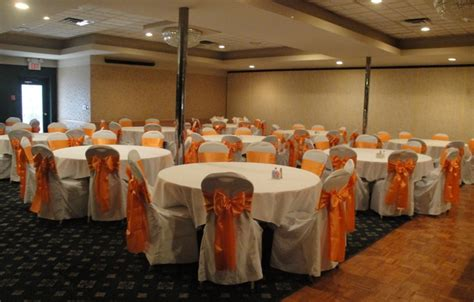 orange satin sashes with white chair covers devoted
