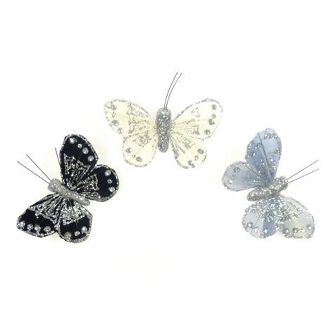 3 papillons plume aimant pour voilage