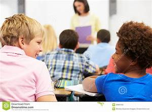 Two Pupils Talking In Class Together Stock Photography ...