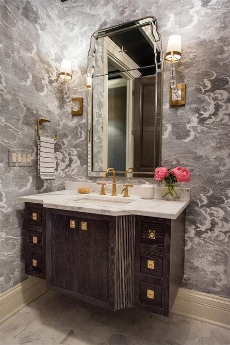 marble  polished brass washstand  black beaded mirror transitional bathroom