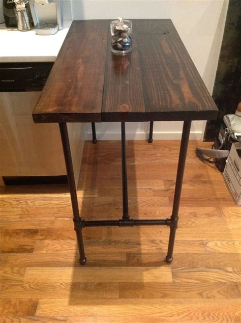 hand  reclaimed wood  black iron pipe table