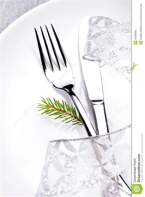 christmas table setting  white  silver  christmas