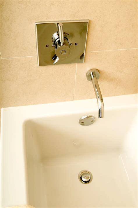 remove  pop  bathtub plug  unclog  drain