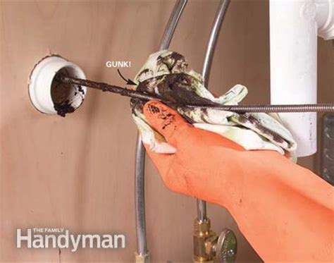 my kitchen sink won t drain how to clear clogged sink drains the family handyman