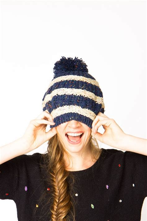 striped pom pom beanie and a pretty fishtail braid get