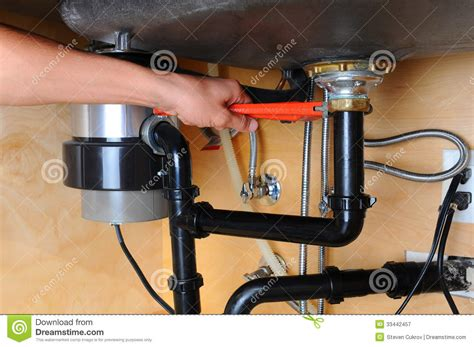 plumber  wrench  kitchen sink royalty  stock