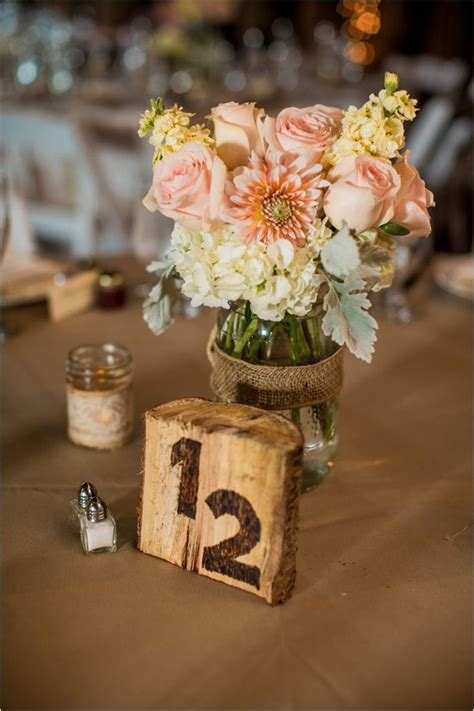 pink and peach barn wedding wedding centre pieces and