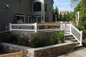 multi tier patio and deck project with outdoor kitchen