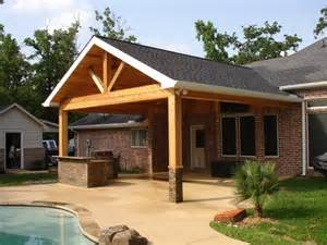 cedar patio cover with outdoor kitchen