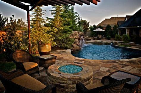 small oklahoma backyard receives  private pool
