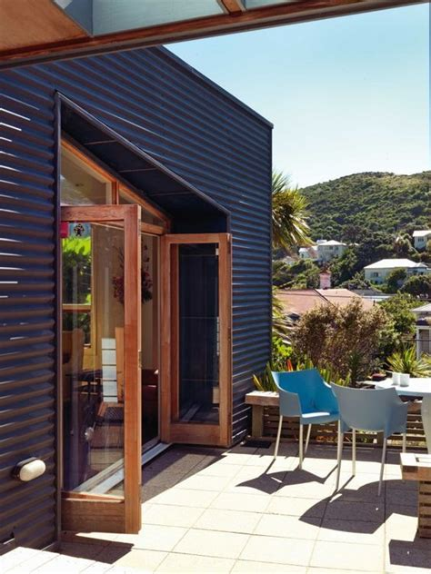 painted corrugated iron exterior walls flank  outdoor