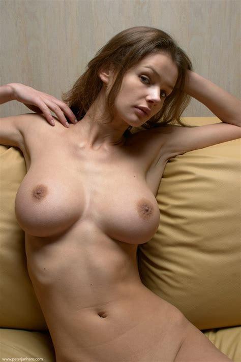 Kristina naked on sofa