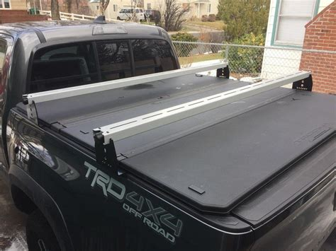 tonneau cover with bed rails toyota tacoma hi rise crossbars for use with tonneau