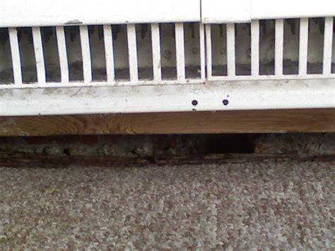huge gaps  baseboards  floor