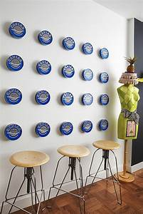 20 caviar cans spaced evenly on a kitchen wall take on an With what kind of paint to use on kitchen cabinets for abstract metal wall art cheap